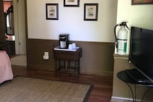 Cottage sitting room with twin daybed and Keurig coffee maker.