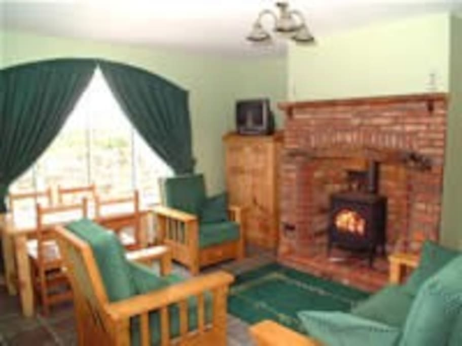 Lounge area with Inglenook fireplace and Norwegian wood burning stove.Free logs supplied!