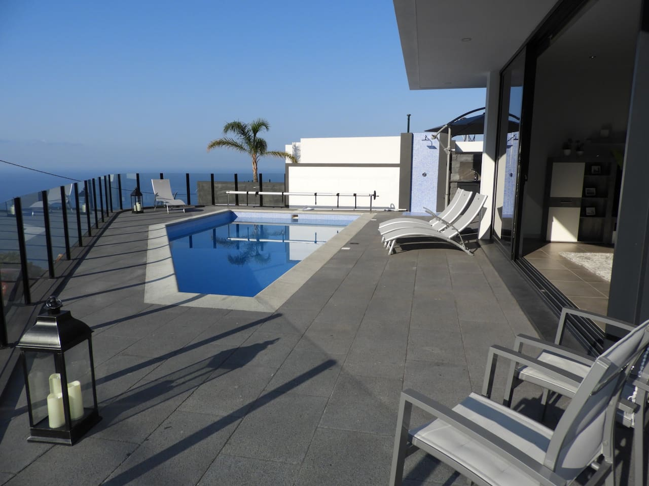 Salt water swimming pool with sun terrace and barbecue