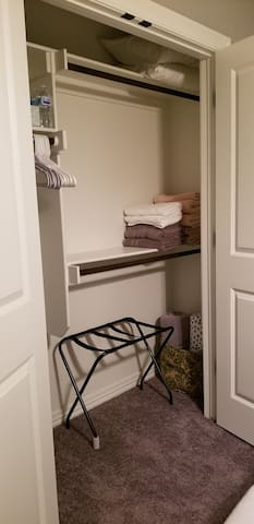 Spacious closet with extra towels and other amenities.