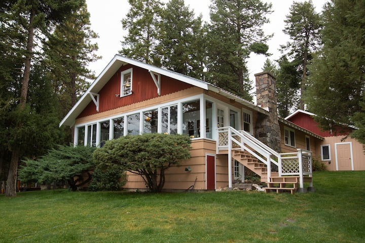 Charming lakefront home w/ a fireplace, dock, & beautiful mountain views