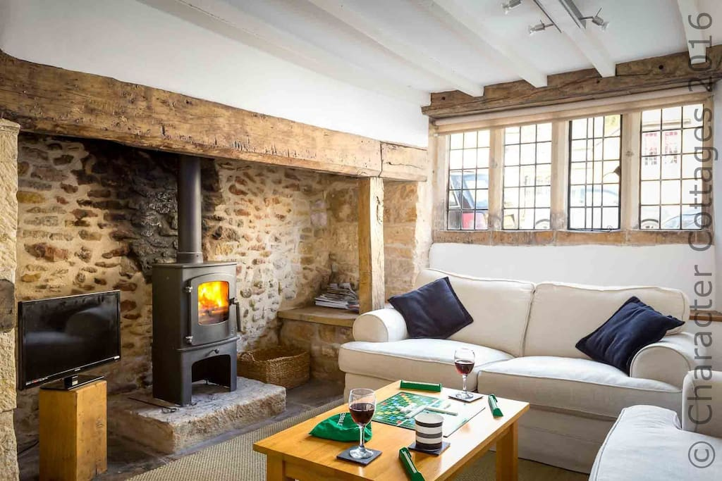 Relax with a glass of wine in front of the wood burning stove