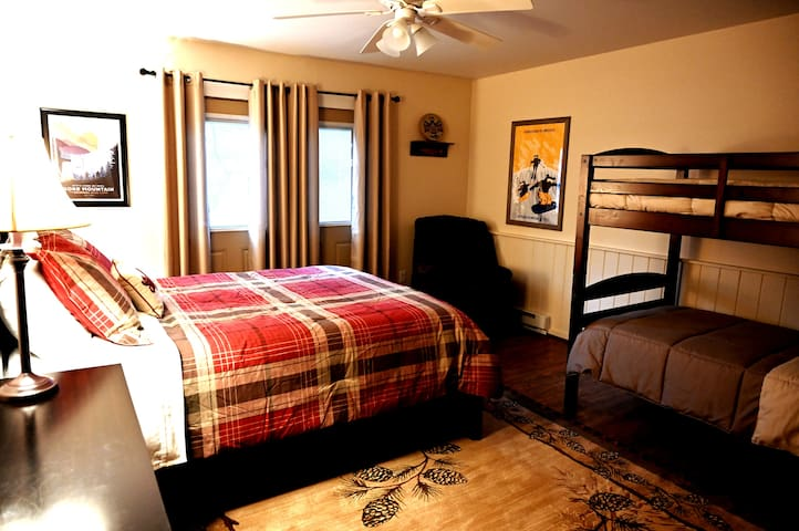 Second floor BR has a queen bed along with bunk beds.  New cotton bedding  and multiple pillows.  Spacious closet and good sized dresser.  Attached bath with shower.  Note - bunk beds are 150 lbs max per bed.