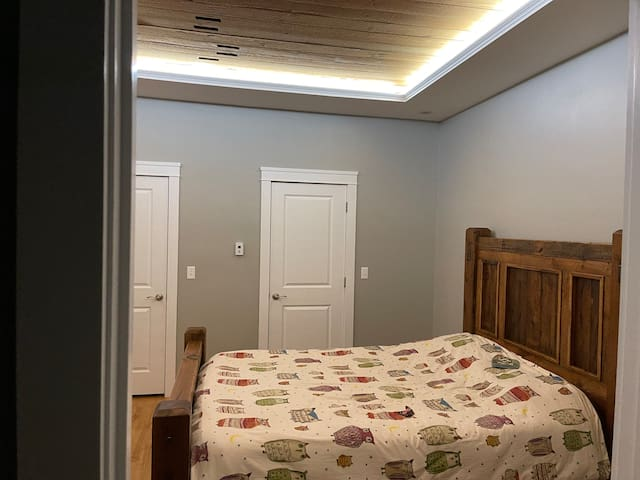 Master bedroom - there are two walk- in closets with plenty of room to feel organized during your stay!