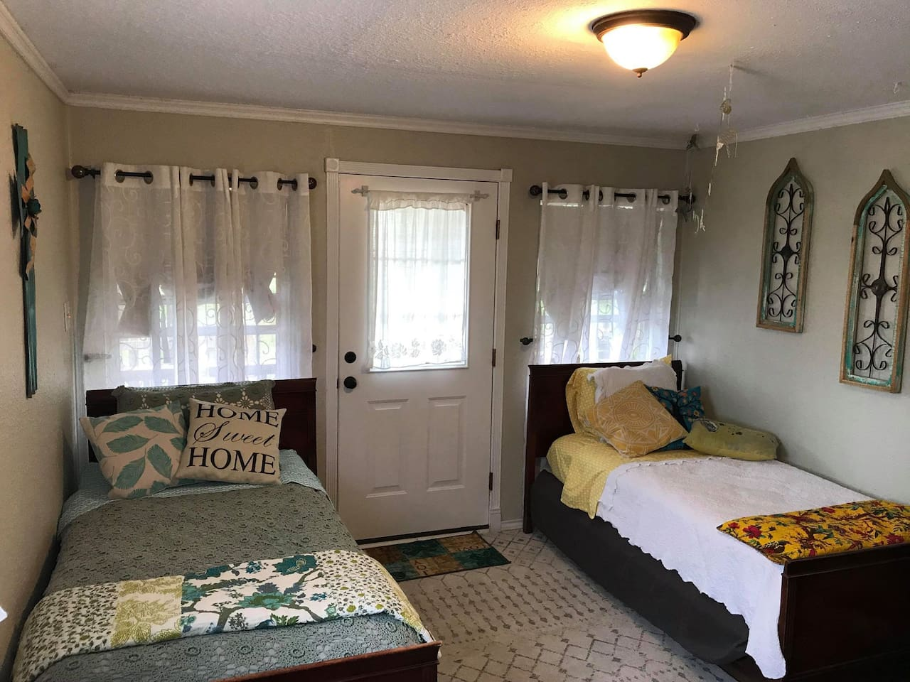 Two twin beds. Beds are family heirlooms, mattresses and linens are new!