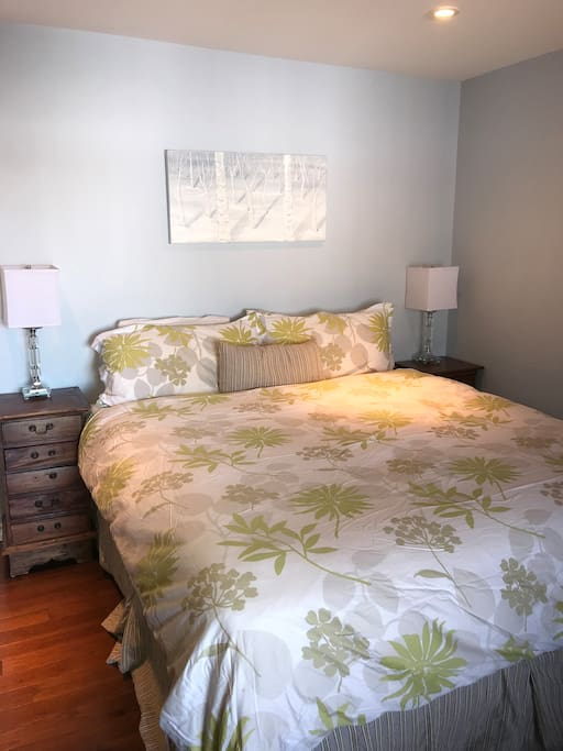 Master King bedroom on main level with access to deck and view of lake
