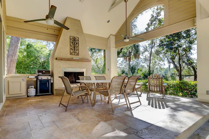 Spend time together on the large covered patio -- complete with a Weber gas grill and wood-burning fireplace.