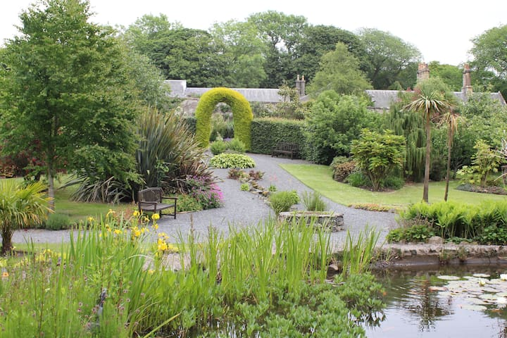 The walled garden with its pond.