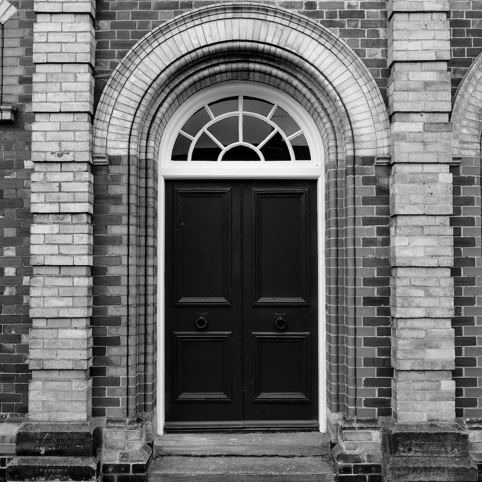 The grand entrance to the converted 1879 apartment block.