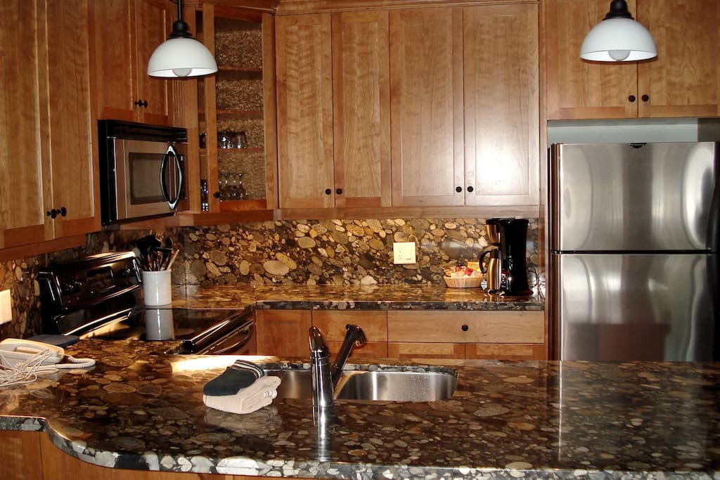 Prepare meals in the gourmet kitchen, complete with granite countertops and stainless steel appliances