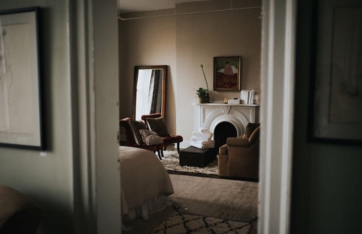 View from second floor common hallway into your room. New furnishings mixed with antique pieces.