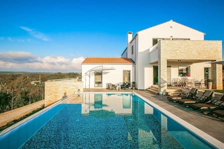 Luxury villa with infinity swimming pool, outdoor jacuzzi and garden
