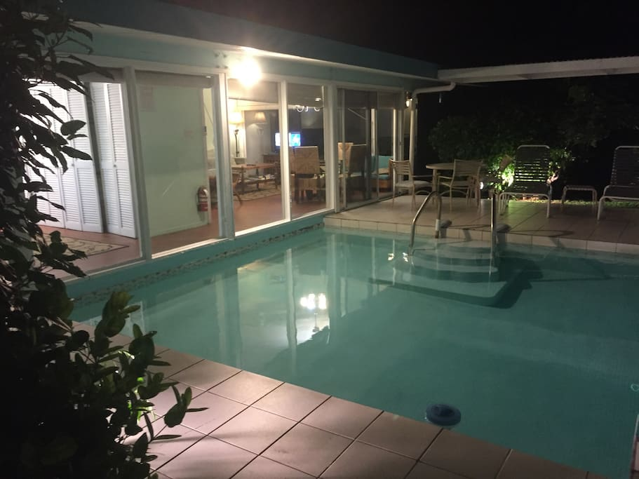 Your pretty house at night with your private pool. Ready for a dip.