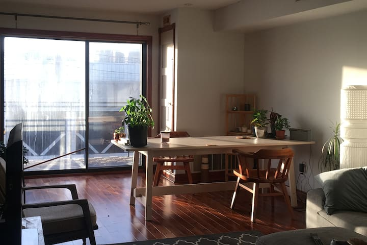 Sunniest Spot in the House! Dining room / work station beside the balcony. West-facing afternoon sunshine.