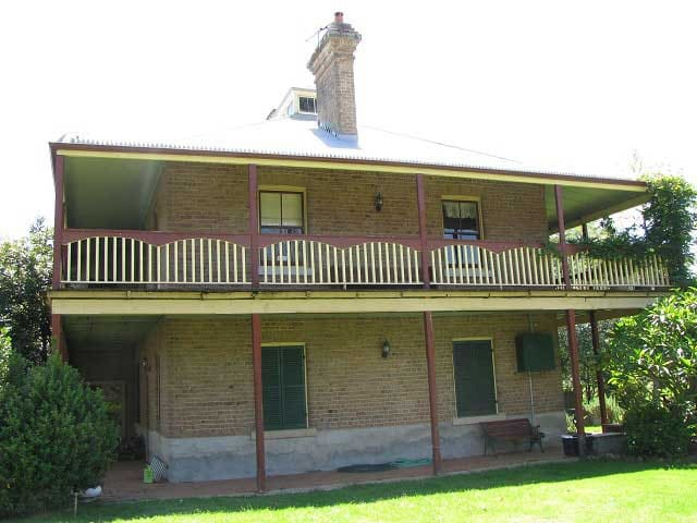 This lovely historic home features a large verandah upstairs and an inviting patio downstairs.