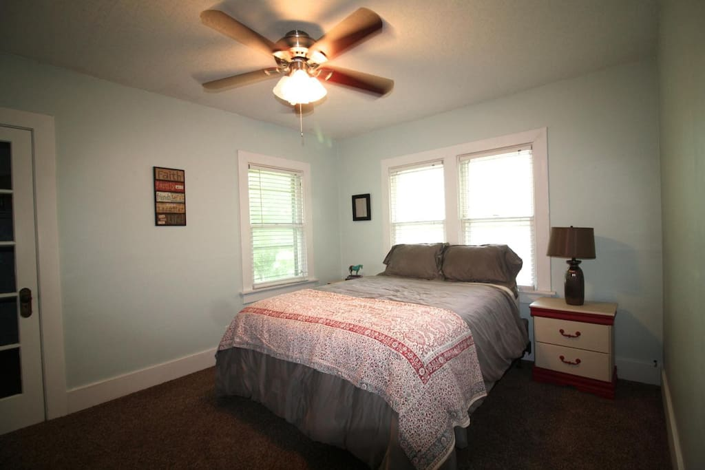 Bedroom #1. Queen sized bed, two end tables to store your things and a spacious closet.
