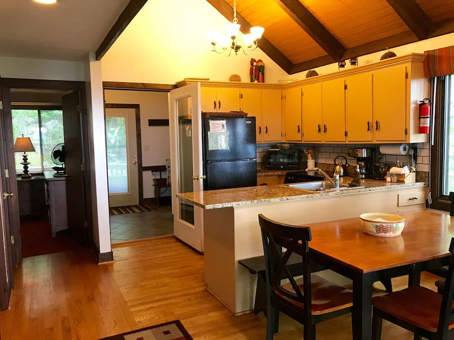 Stocked kitchen, updated fixtures, mudroom entry, and granite counters.