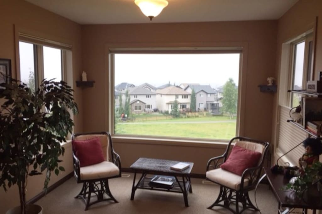 This is also part of this master suite  and is a perfect sunny spot to read, work or just sit and take in the view.  Ideal for short and long term business travelers, too.