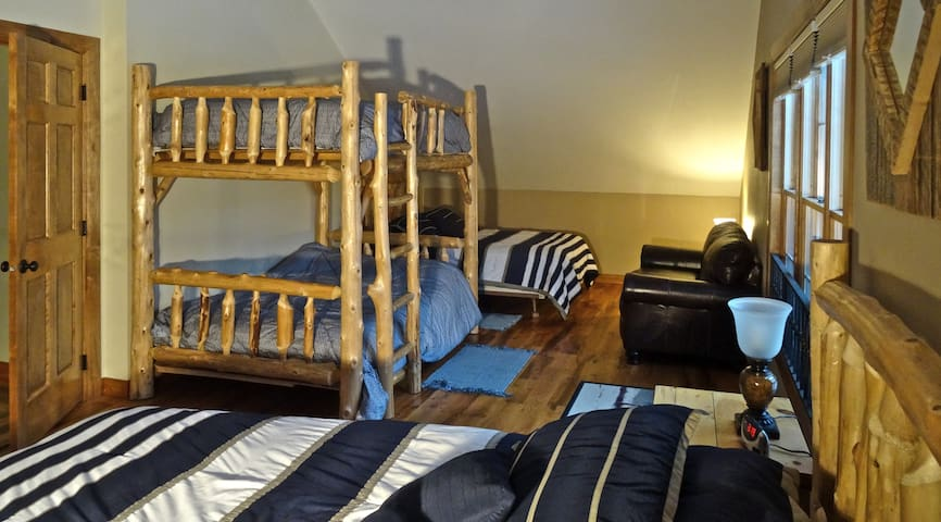 All the kids just love this room with a double full bunk bed and another queen and full size beds
