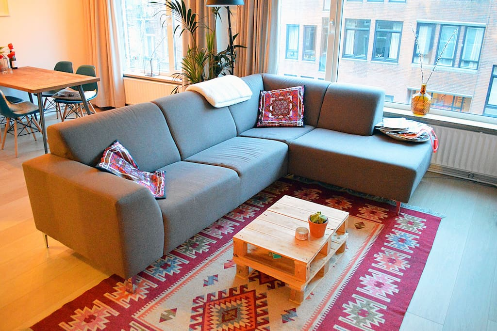 Relax on this soft couch after a lovely day in Amsterdam