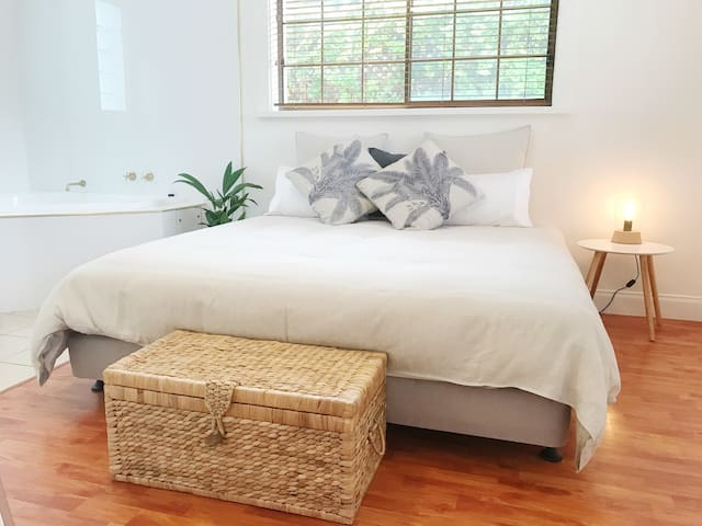 Your main bedroom with luxury king size bed, ensuite spa and walk in wardrobe.