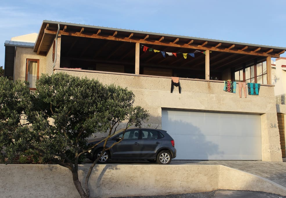 The Rustic Beach House with great views over the Atlantic Ocean & Table Mountain.  It has a garage with space for 2 cars.