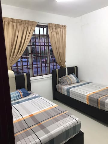 Another room with 2 single beds .