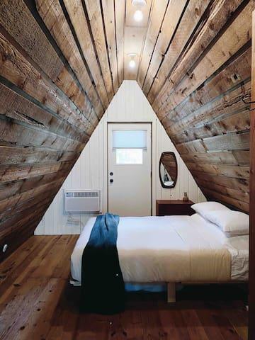 Bedroom in loft with queen-sized bed