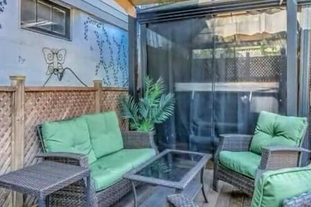 Entire apartment with large Backyard and hot tub