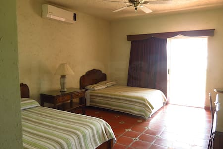 Habitación 2 camas matrimoniales