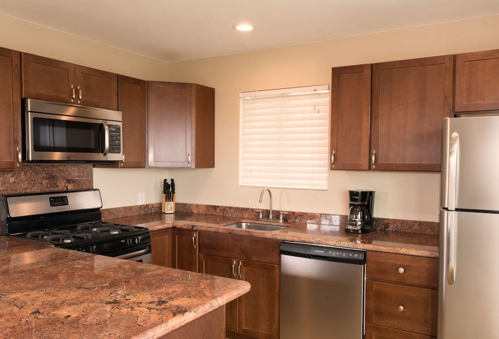 Full kitchen with granite counters and stainless steel