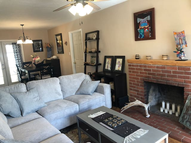 Picture of our lovely artistic living room looking towards our dining area.