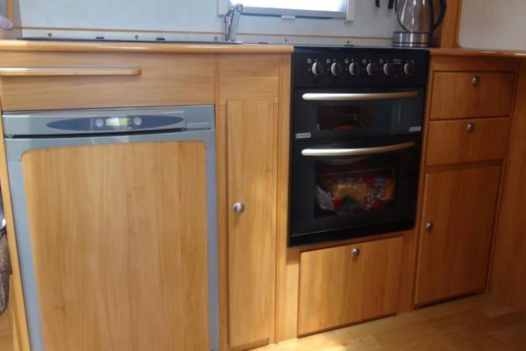 Fridge, gas oven, 4 burner gas cook-top