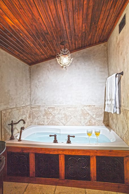Jetted Tub for 2 with mini chandelier and beadboard ceilings