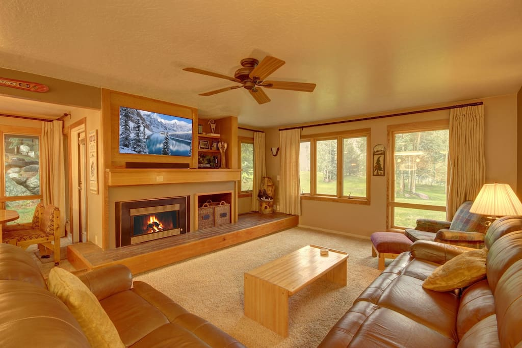 This property has amazing windows with views of mature aspen and evergreen trees.