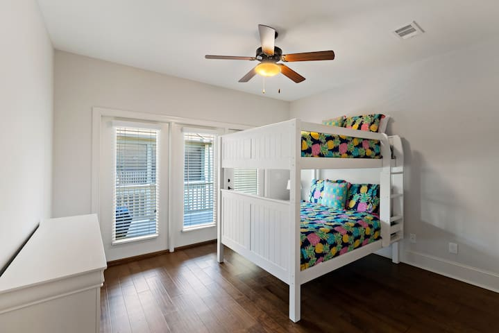upstairs bedroom with 2 double beds