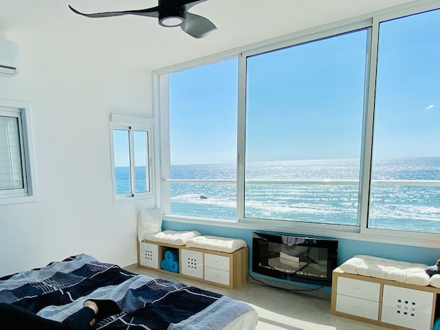 Sea Front Master Bedroom - amazing reading nooks to enjoy your morning coffee