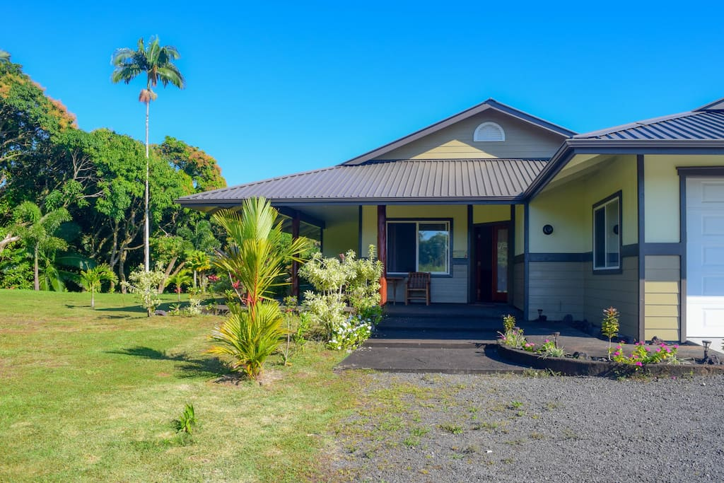 Kahawai Hale's 3 acres include a large yard, stream, pond and waterfall.