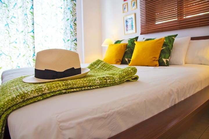 The master bedroom has an exotic style in calm golden & green tones, will help you relax and enjoy!