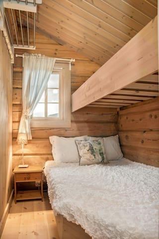 Bedroom 3 - queen bed (120 cm) plus single bunk bed, and storage shelf.