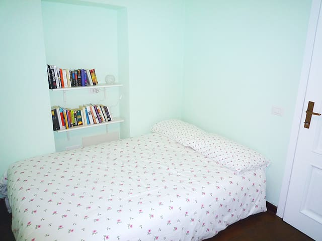 The second bedroom, with a comfortable full-size double bed