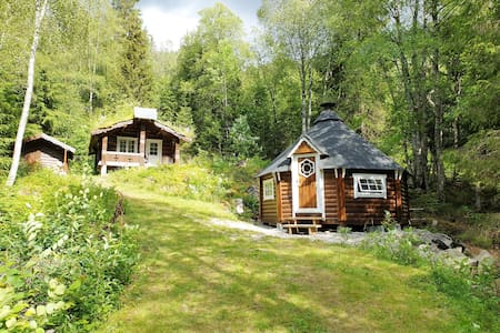 Cozy lowcabin, sauna & barbecue hut and rowboat