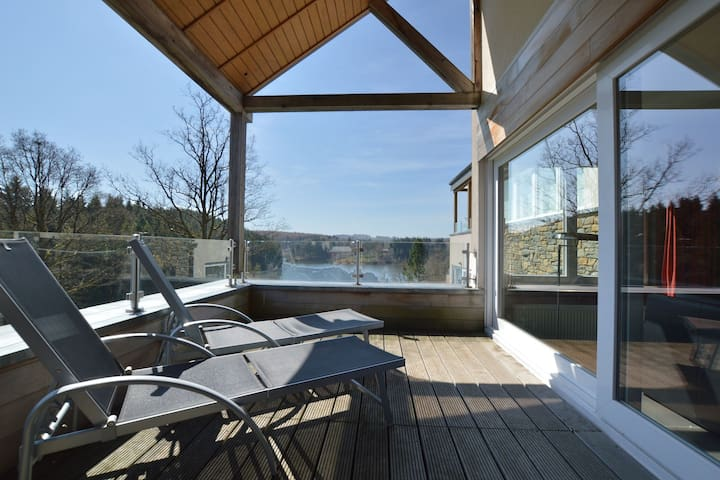 Luxury holiday apartment with a sauna, fireplace and views over a lake