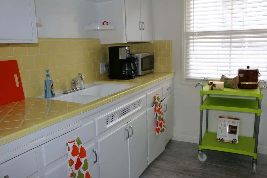 Cute full kitchen for cooking before day at the beach.