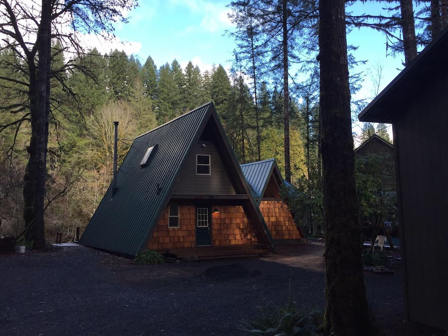 The newly renovated cabin is nestled in the trees on the bank of the Little North Fork of the Santiam River.