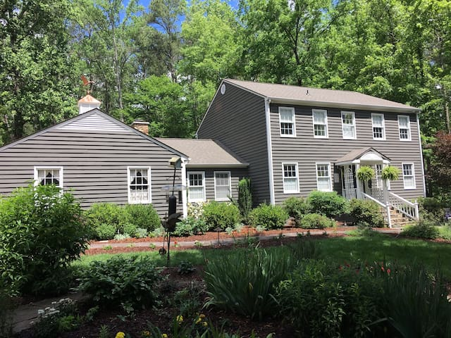 Sunny 4 BR home; wooded privacy + super comfort