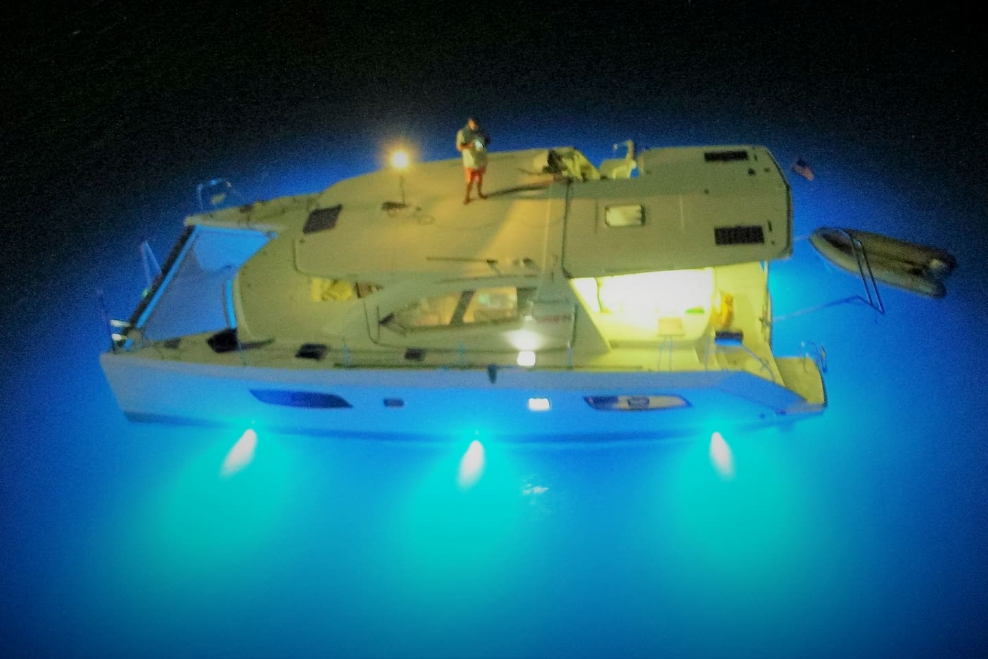 Boat at night with under water lights on