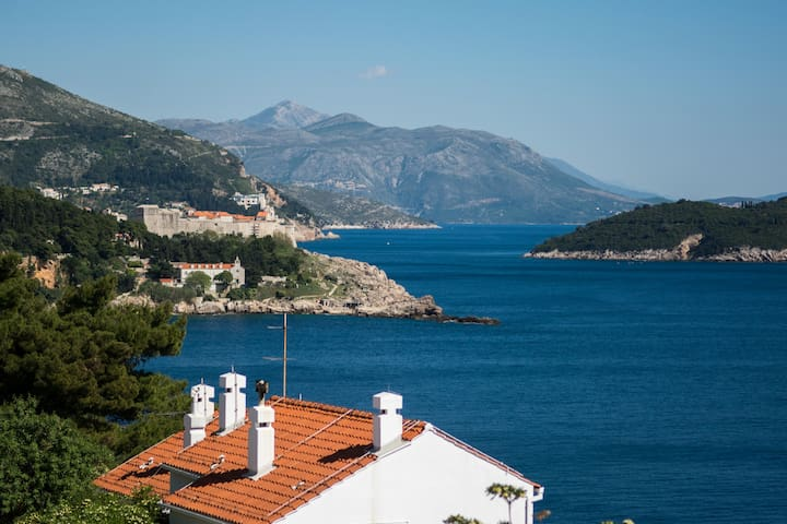 view from the balcony to city walls and island Lokrum