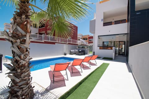 Modern bungalow with private heated pool