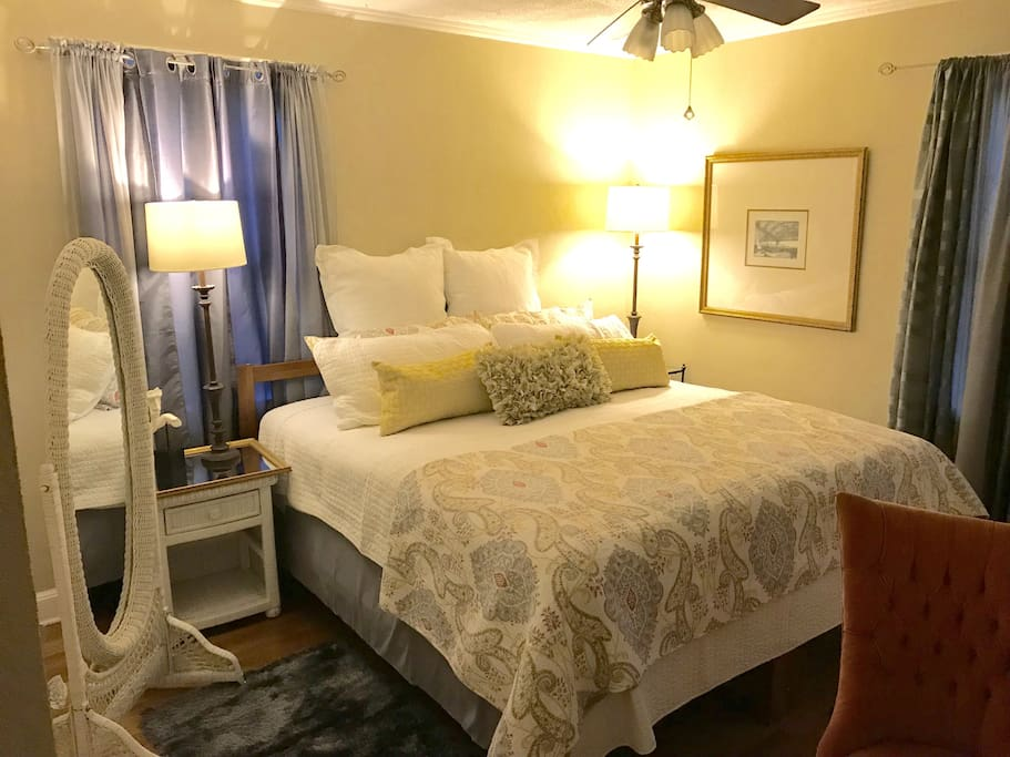 Master bedroom with king-size bed and lovely linens